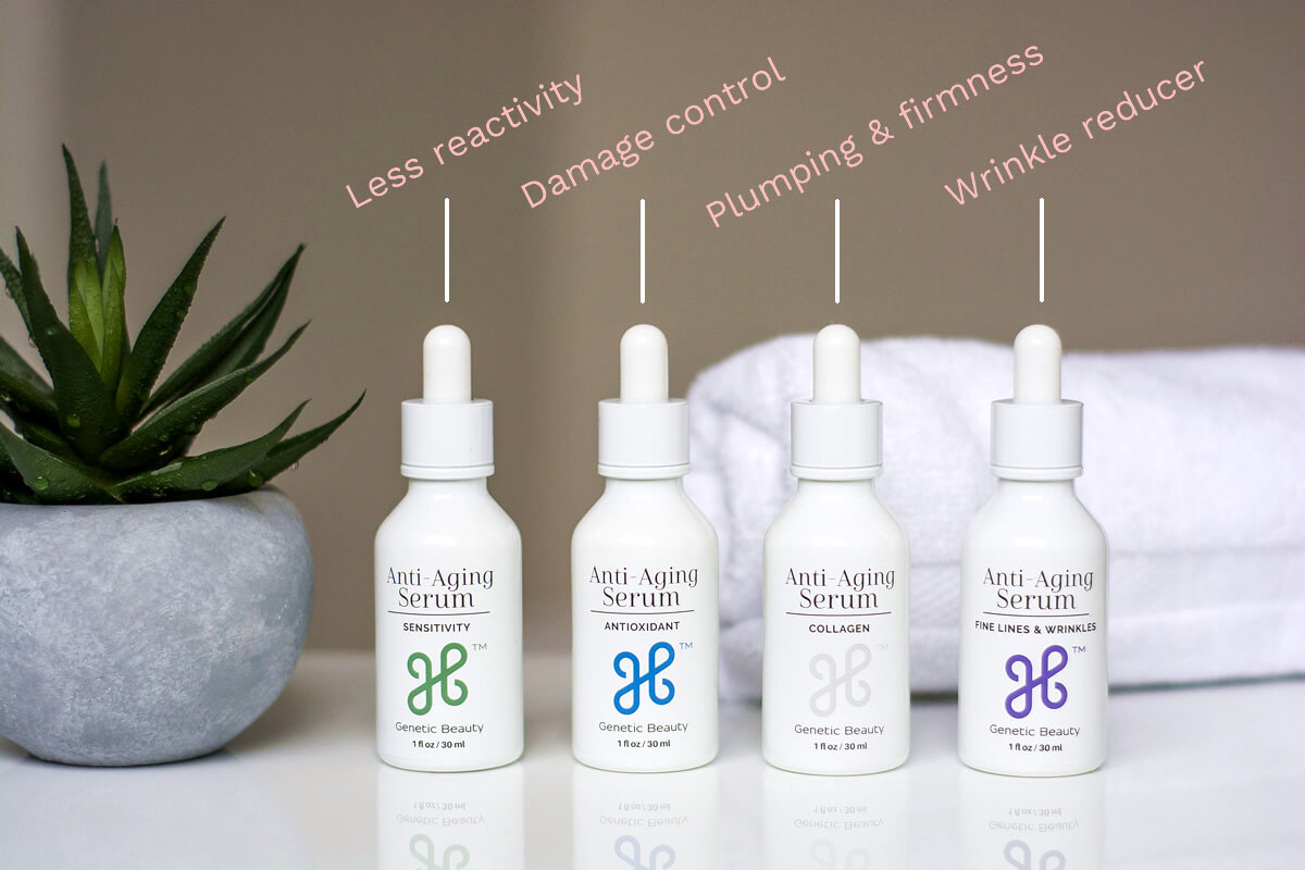 Anti aging skincare serums displayed on a white table as a part of Genetic Beauty review
