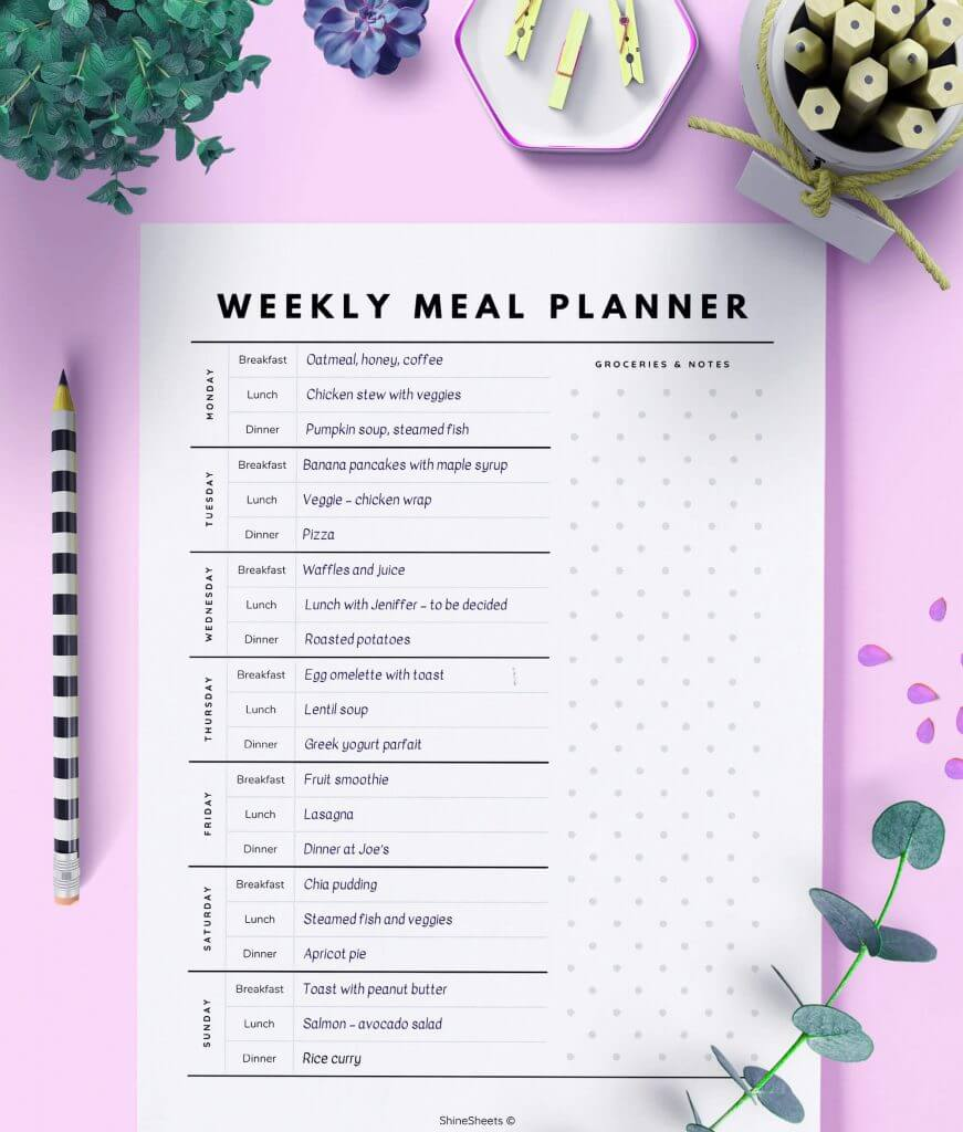 Weekly Meal Planner Template on the table with pencils