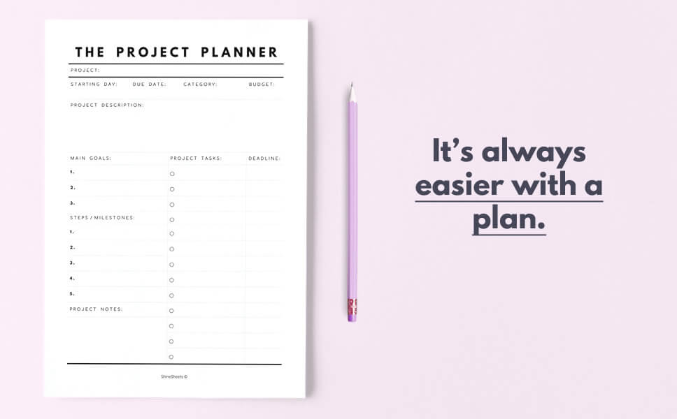 A quote on how to get things done with a display of project planner and pink pencil