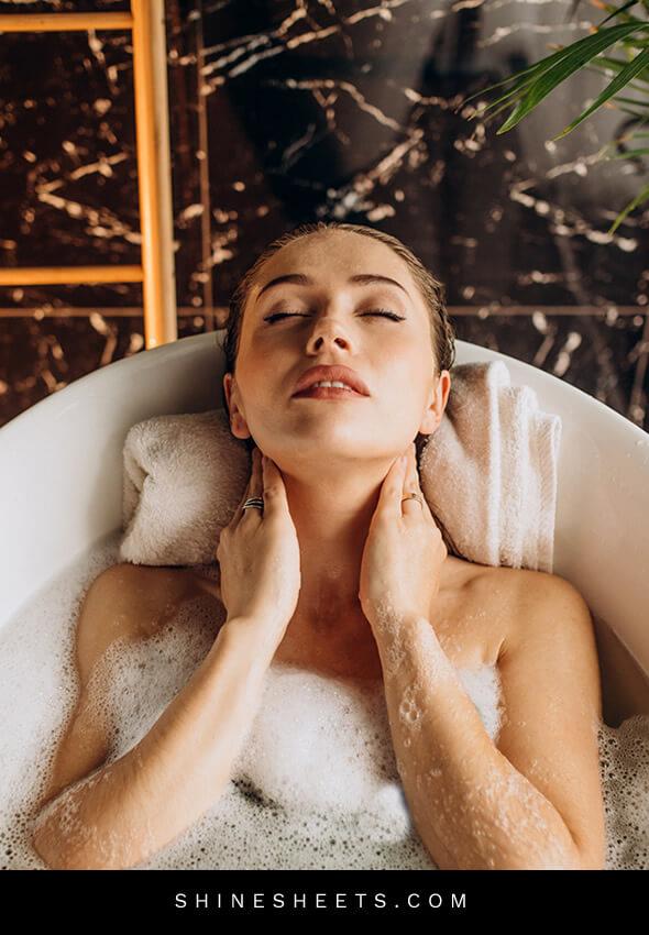 woman in a relaxing hotel bath