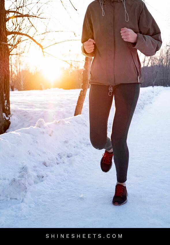 woman jogging outside in winter
