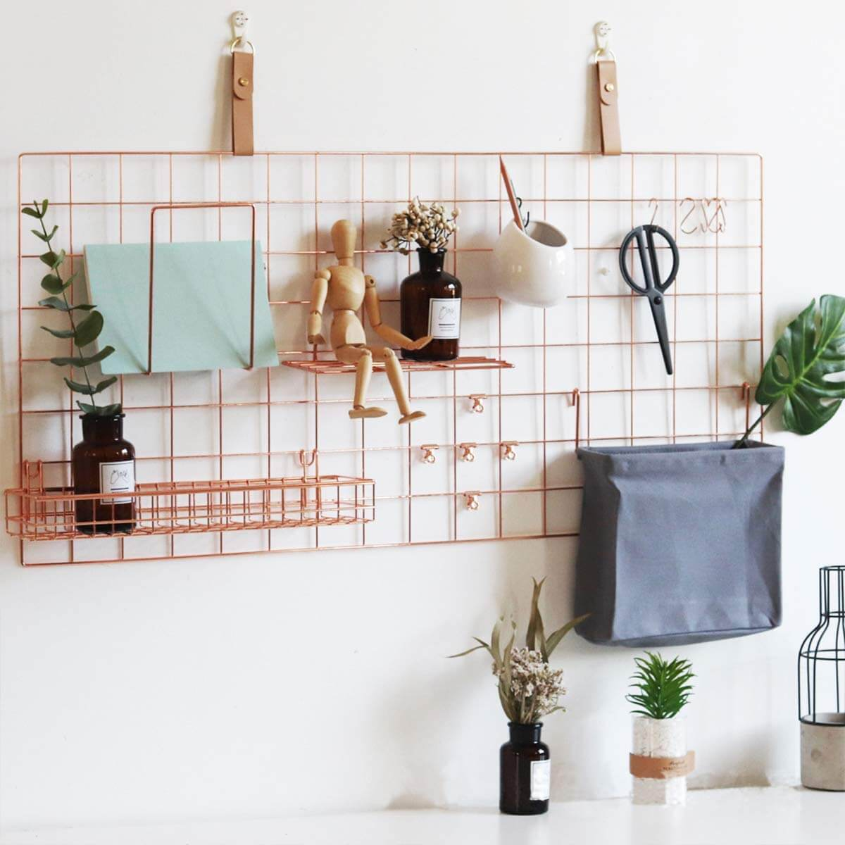 rose gold wall panel with random things as an idea of how to get organized
