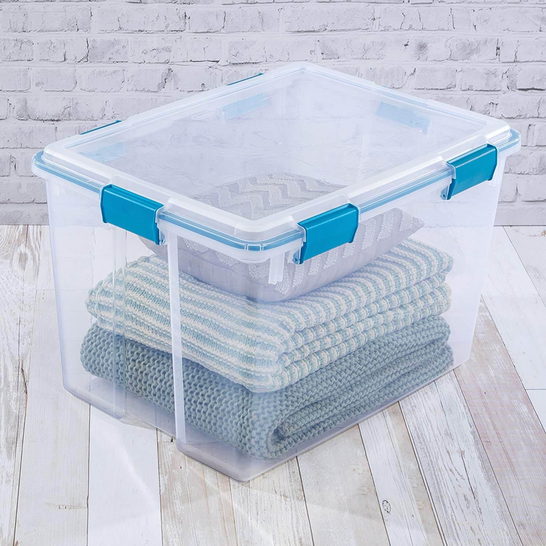 plastic bin with sweaters inside