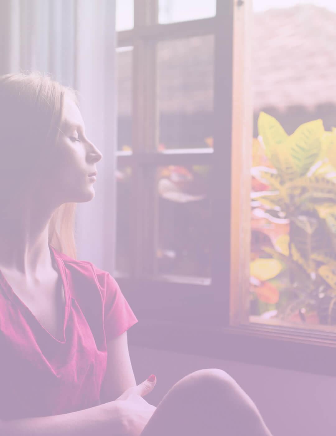 woman enjoying fresh air in her meditation room