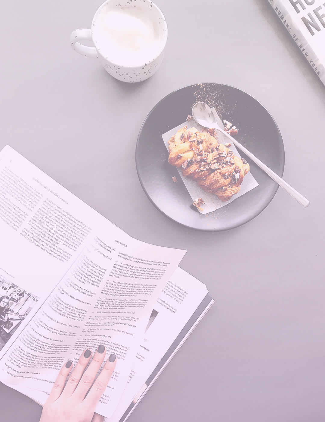 woman eating tasty breakfast and reading newspaper