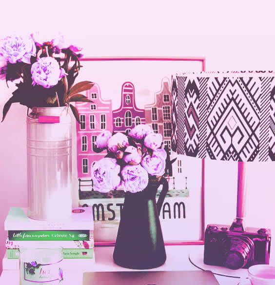 Beautiful desk with flowers as a symbol of home organization