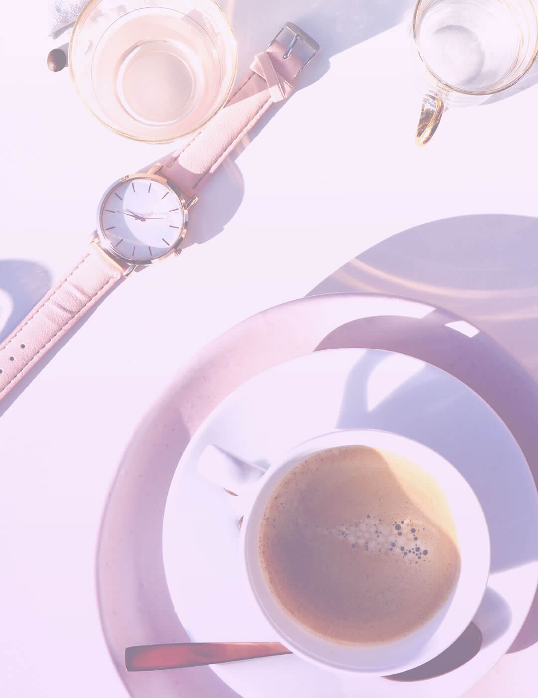 a cup of coffy and a watch as tools to improve work efficiency