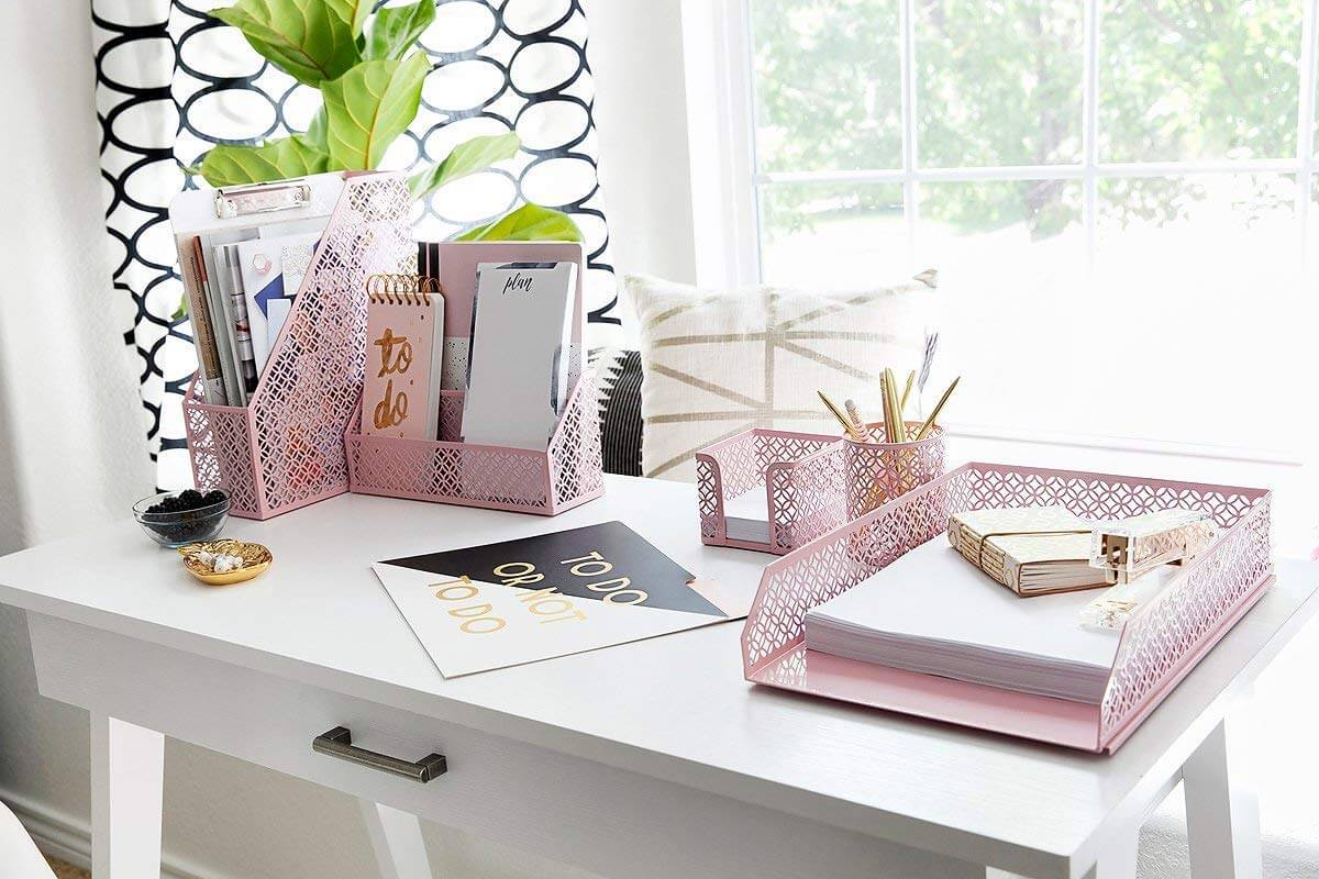 Pink desk organizers used on table as one of productive things to do when bored