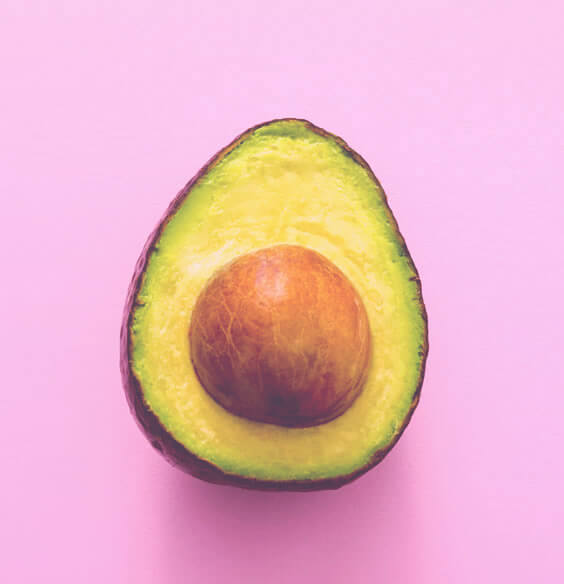 avocado on pink background