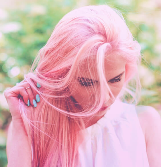 pretty woman touching her pink hair