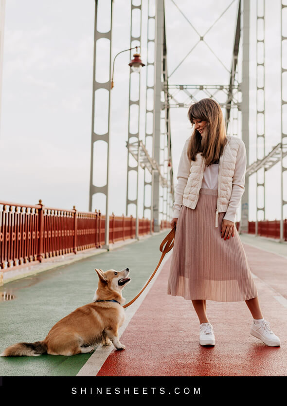 stylish happy woman walking her dog as an example of how to enjoy life