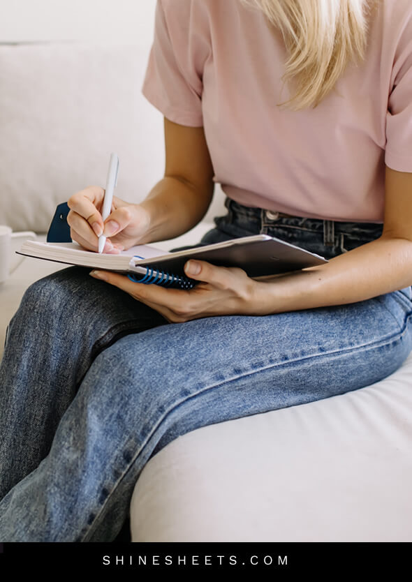 woman doing a writing exercise to improve her cleaning motivation