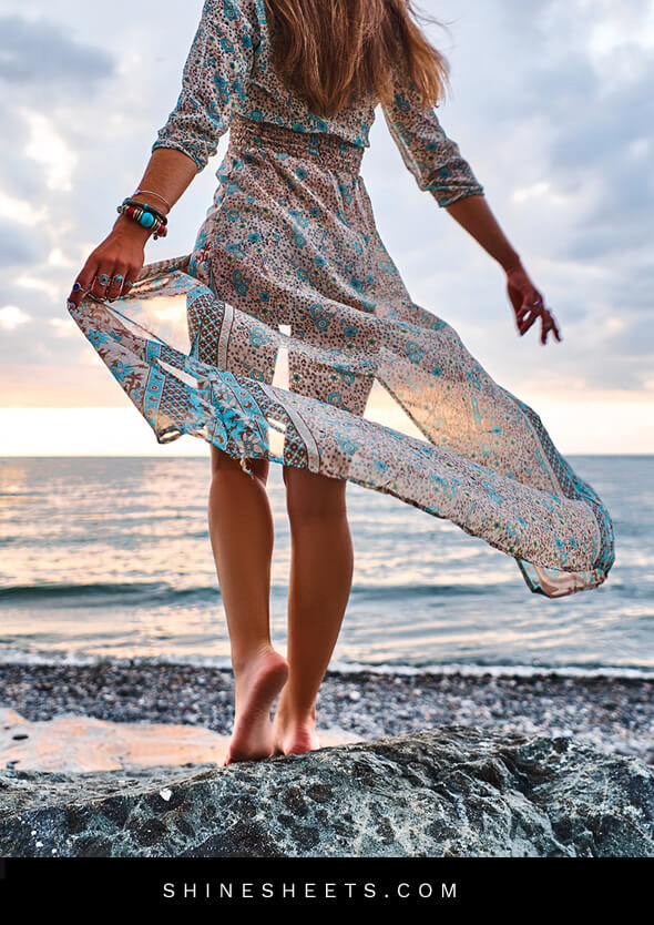 woman walking on the beach in a beautiful flowing dress