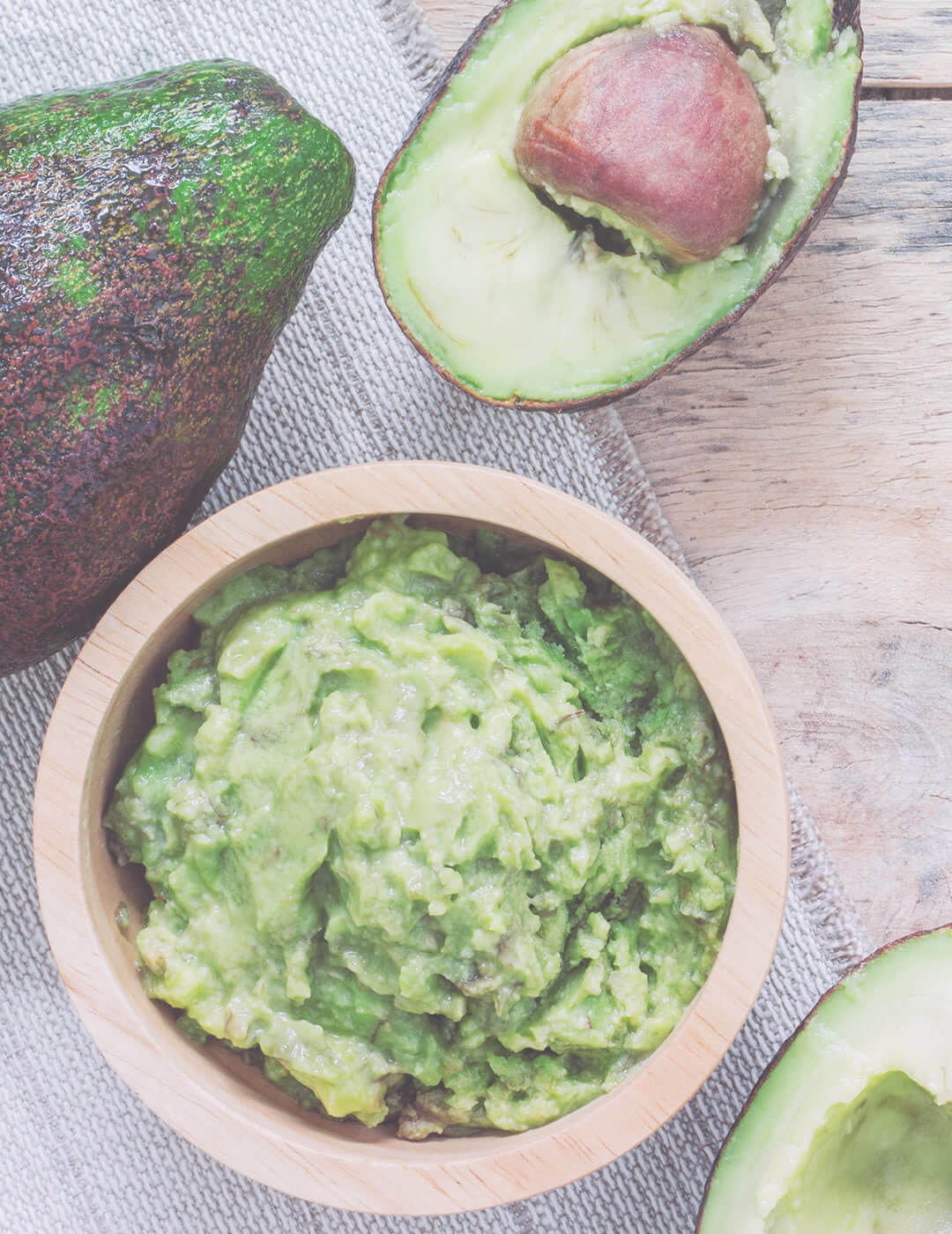 mashed avocado as one of the home remedies for dry and frizzy hair