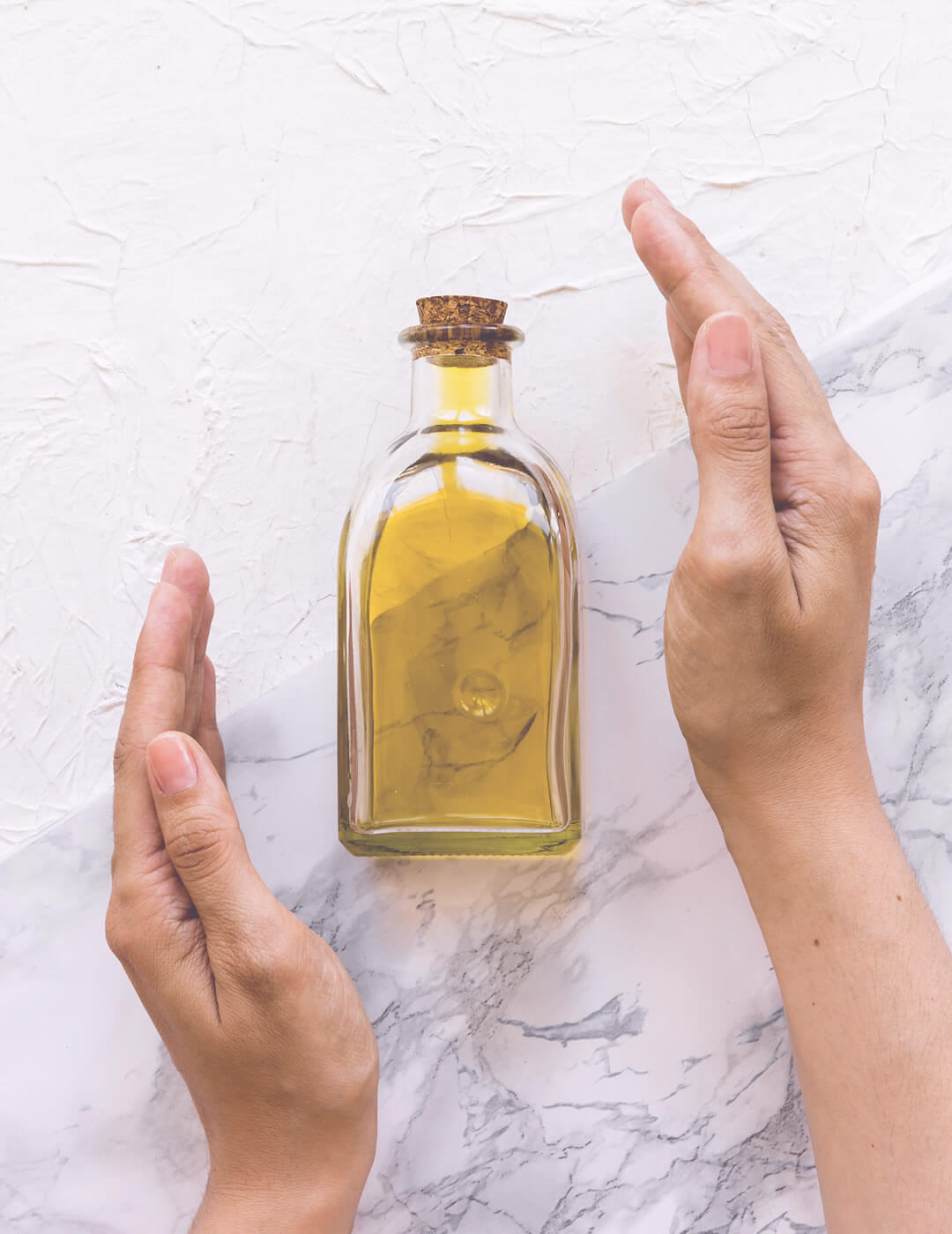 olive oil as one of the best home remedies for dry and frizzy hair