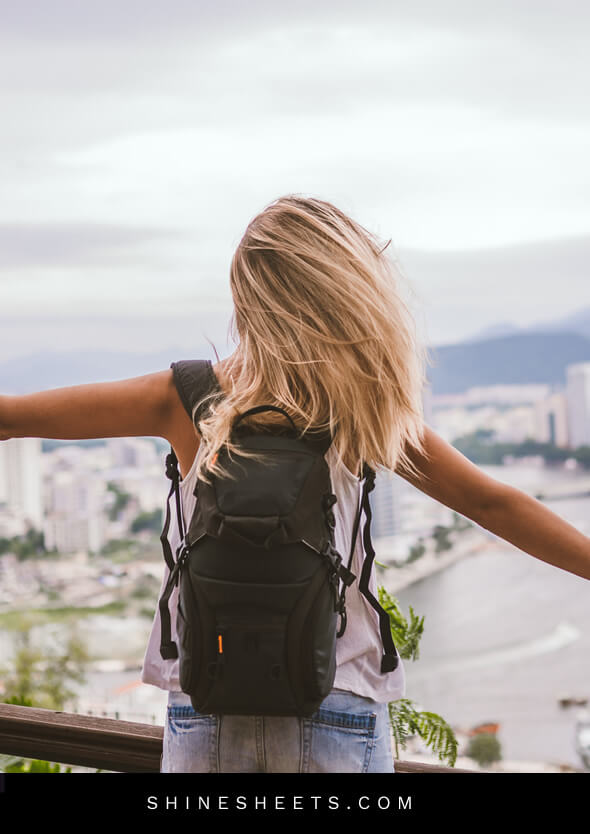 happy woman on top of the city traveling to let go of the past