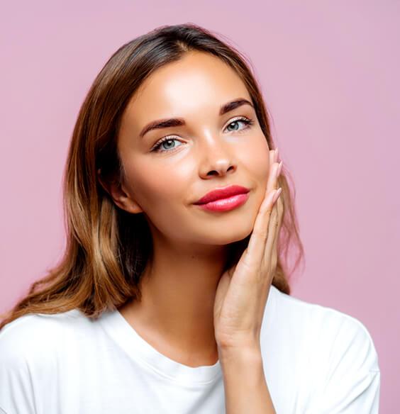 woman with red lipstick touching beautiful skin