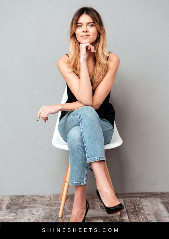 woman sitting on a chair as an example of protective body language