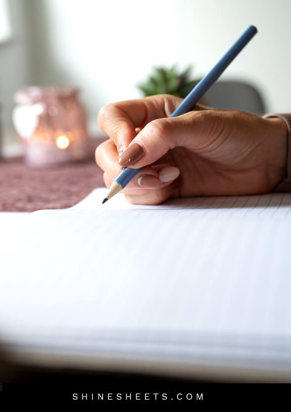 woman writing in a journal to learn how to love yourself