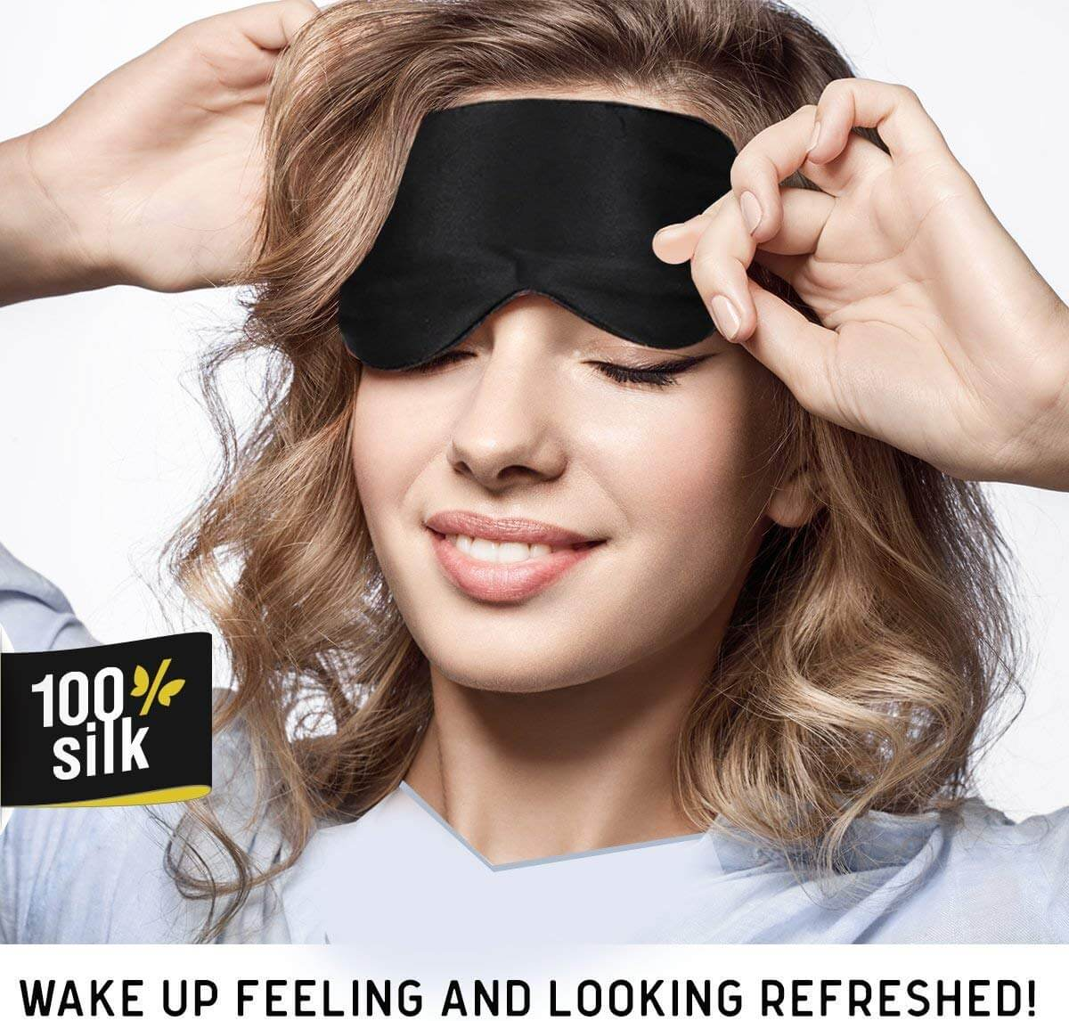 A young girl with brown curly hair is using a black sleep mask