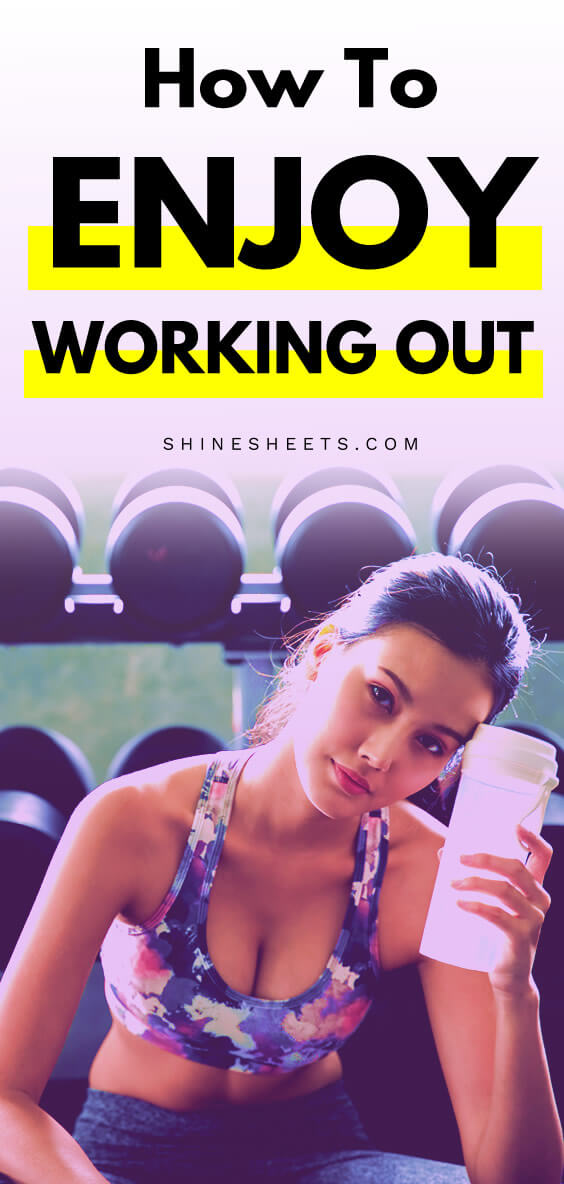 Fit and healthy young woman holds water bottle after her workout