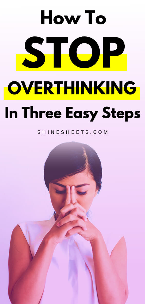 A woman is overthinking and holds her head