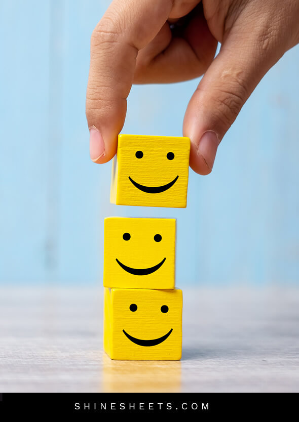 person building smiling blocks as a concept of living happier by choice
