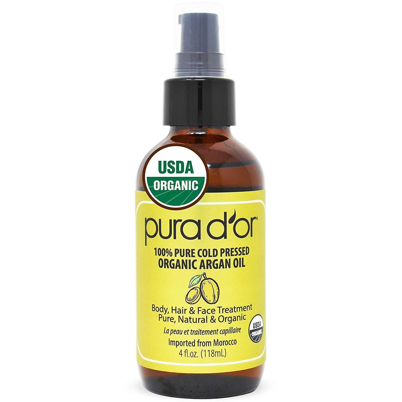 A bottle of pura d'or organic argan oil for oily skin