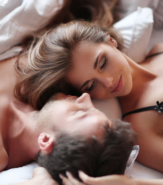 couple sharing intimacy and romance in bed
