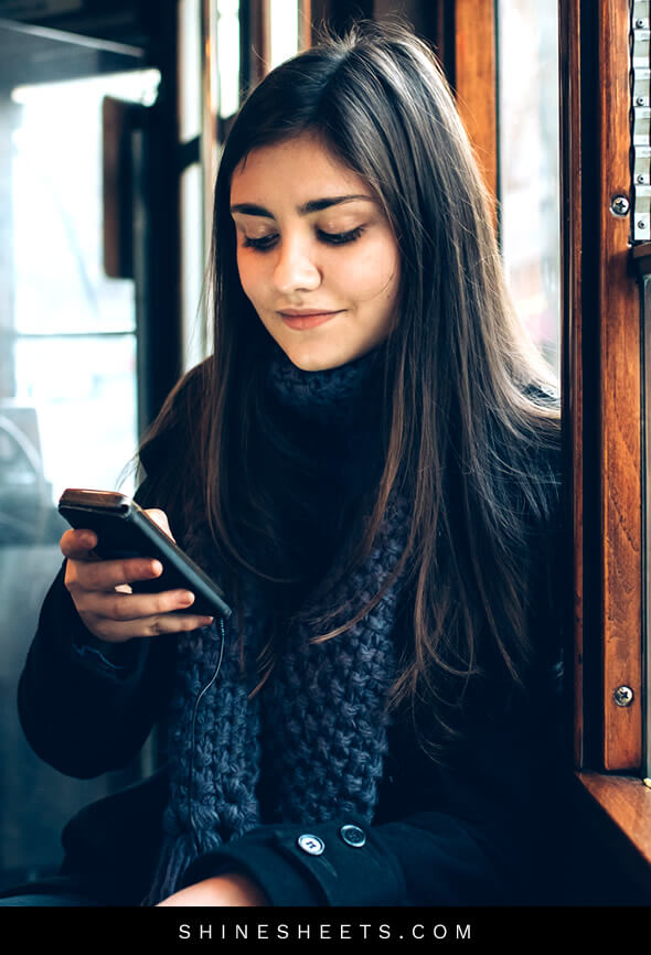 woman commuting receives a text message from her crush