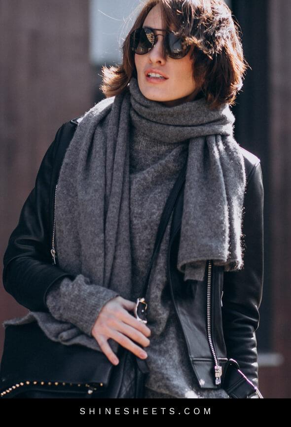 woman with a nice grey scarf as an example of how to look expensive