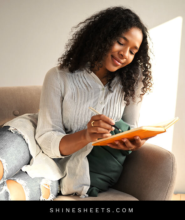beautiful black woman journaling to stop expecting the worst
