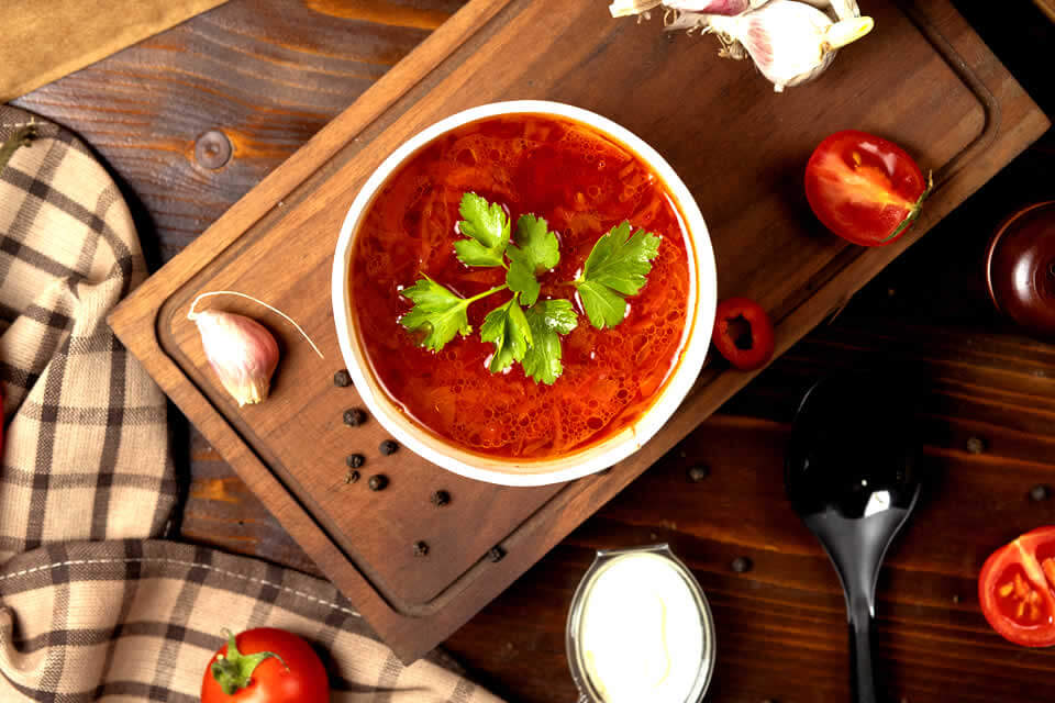 Anti-inflammatory tomato soup on a wooden table