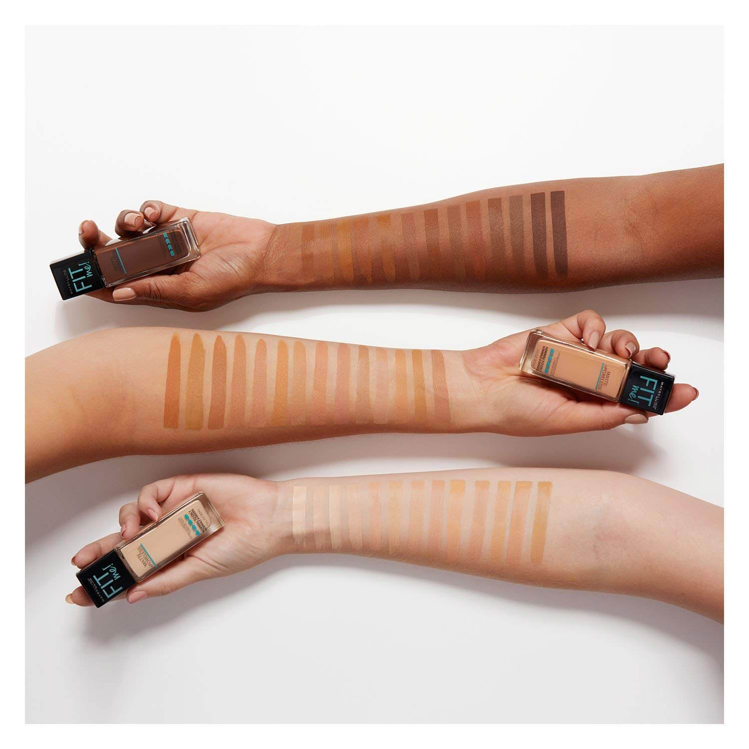 Hands showing range of Maybelline Fit Me foundation shades