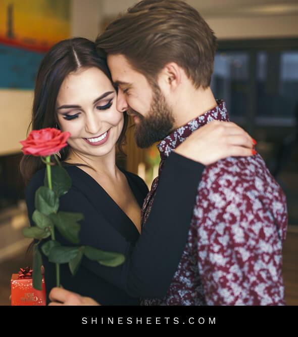 a happy woman receiving a red rose from her husband
