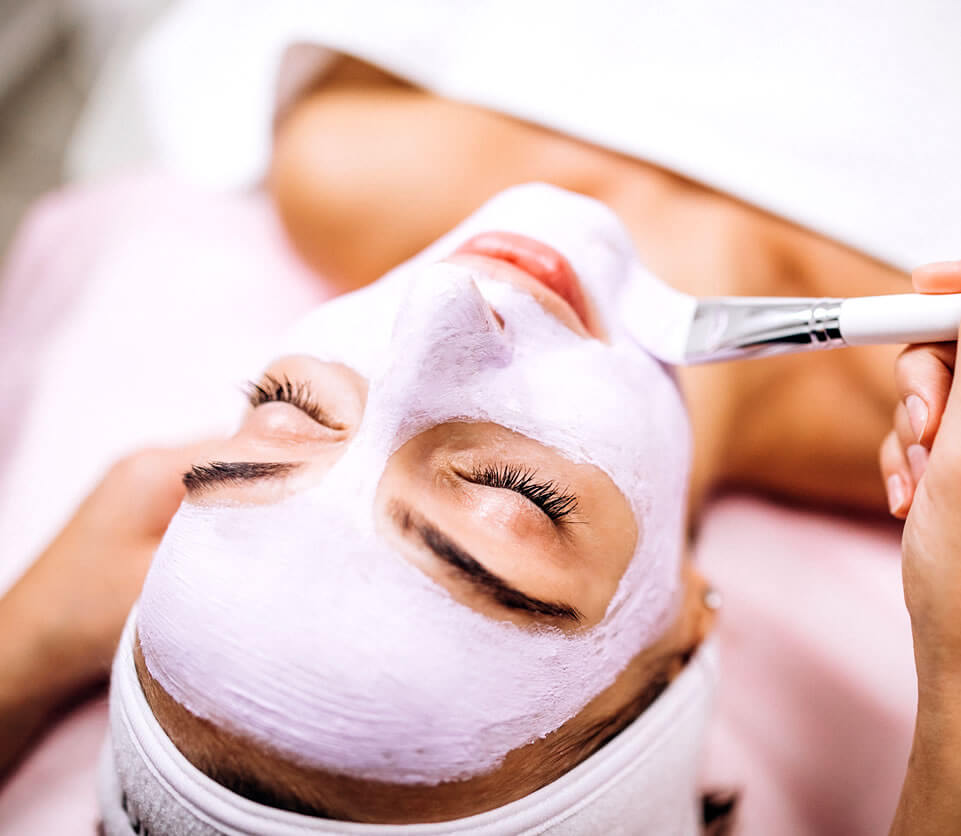 Woman trying out facials for acne at the salon