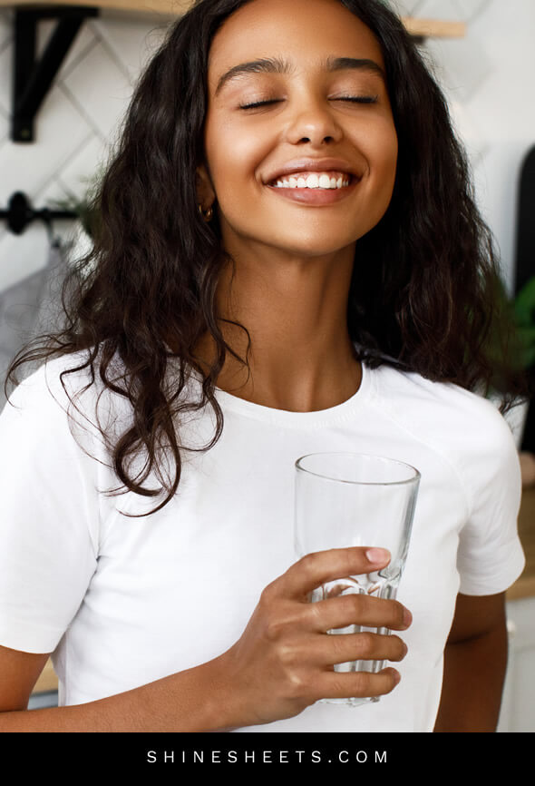 pretty woman with slim face drinks water