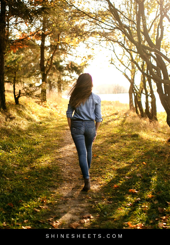woman taking a walk in nature to find inner happiness