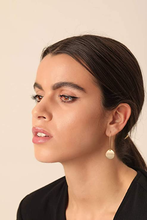Beautiful woman shows how to be pretty with statement earrings