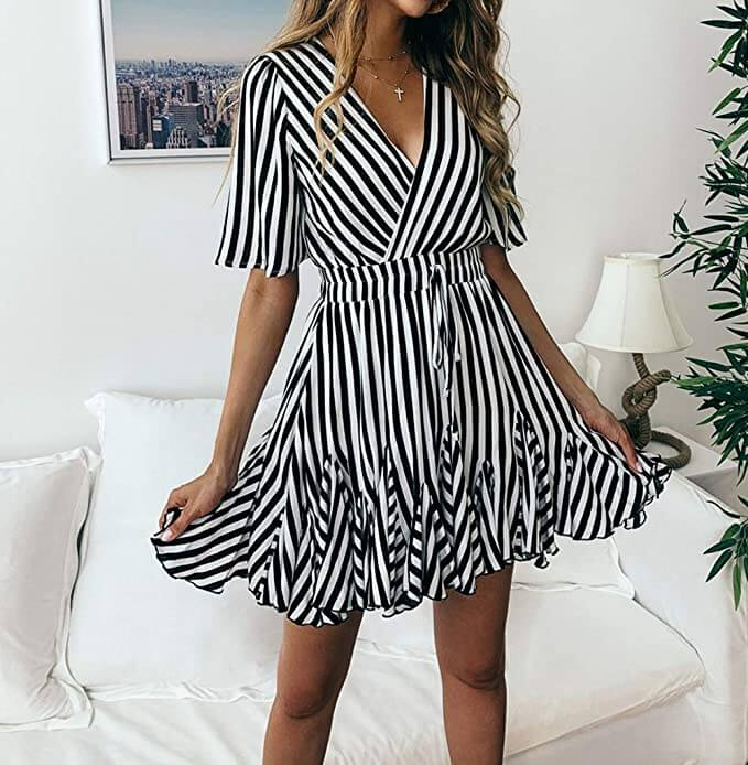 Tanned blond girl shows how to be pretty with monochrome dress