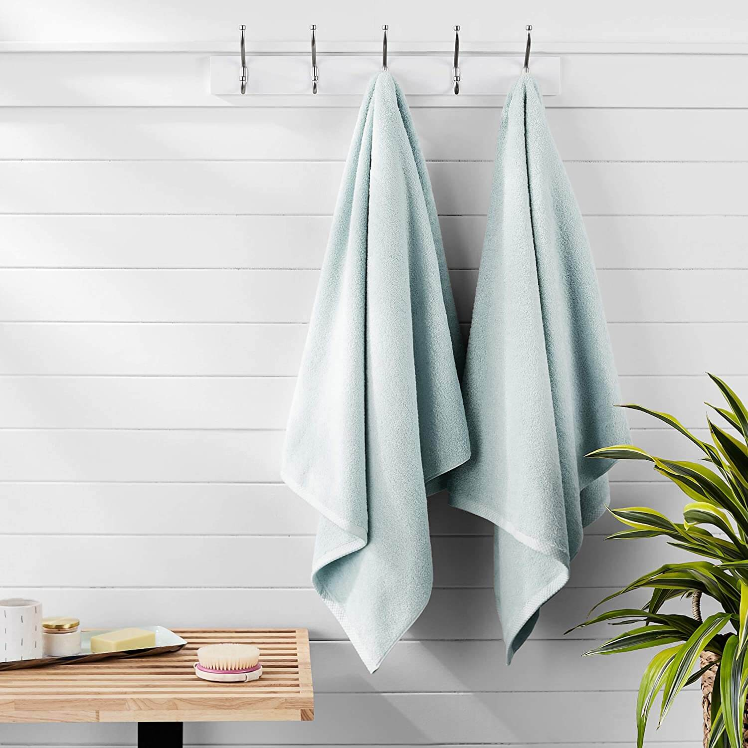 Neat and clean mint towels hanging in the bathroom