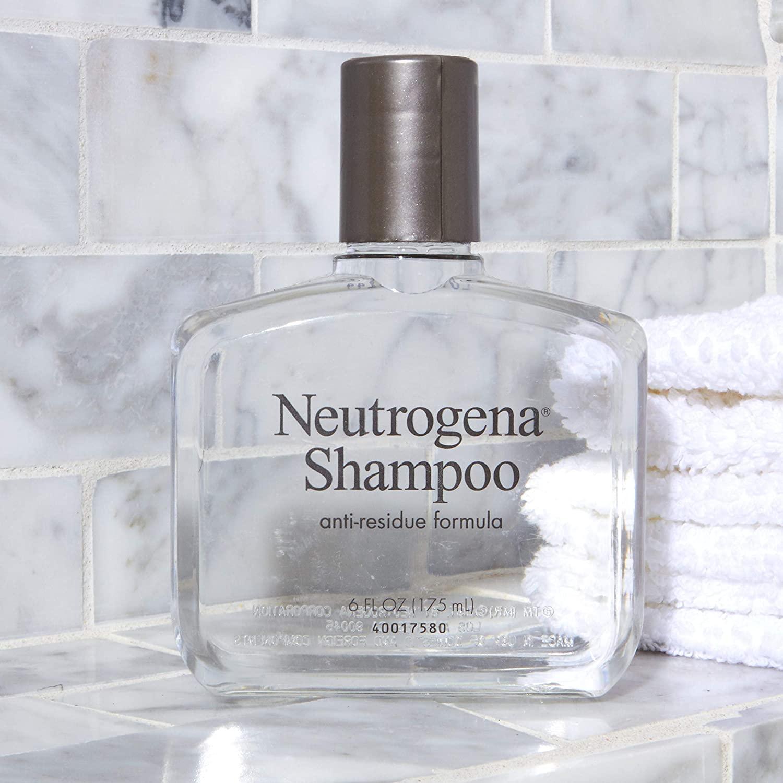 Neutrogena clarifying shampoo on bathroom shelf as one of the tips for healthy hair