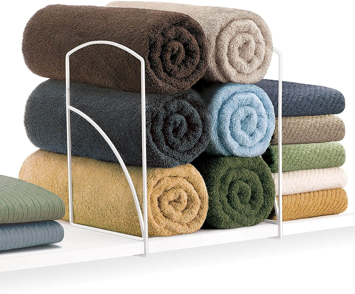 Linen shelf dividers with neat and clean towels