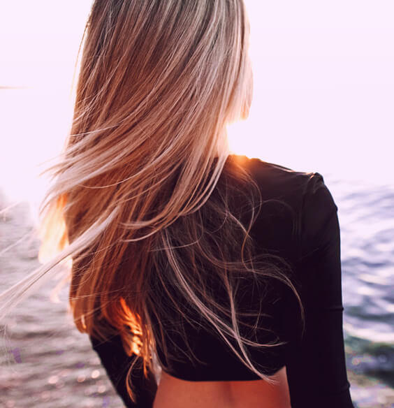 Long blonde hair after using tips for healthy hair