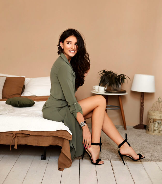 Beautiful brunette woman in dress and stilleto shows as an example of good dressing sense