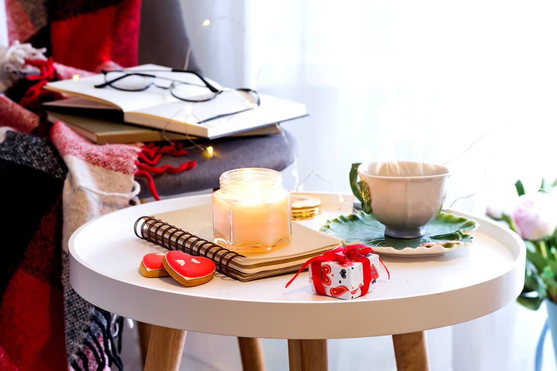 Journals, candles and tea as ways to practice self love