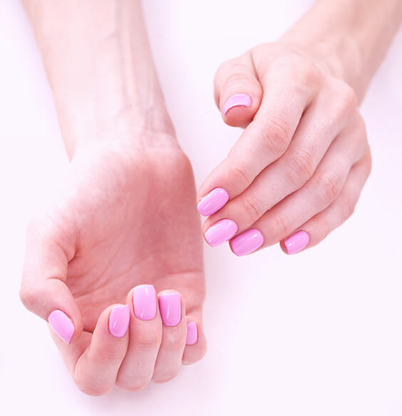 Brittle nails shown painted with pink nail polish