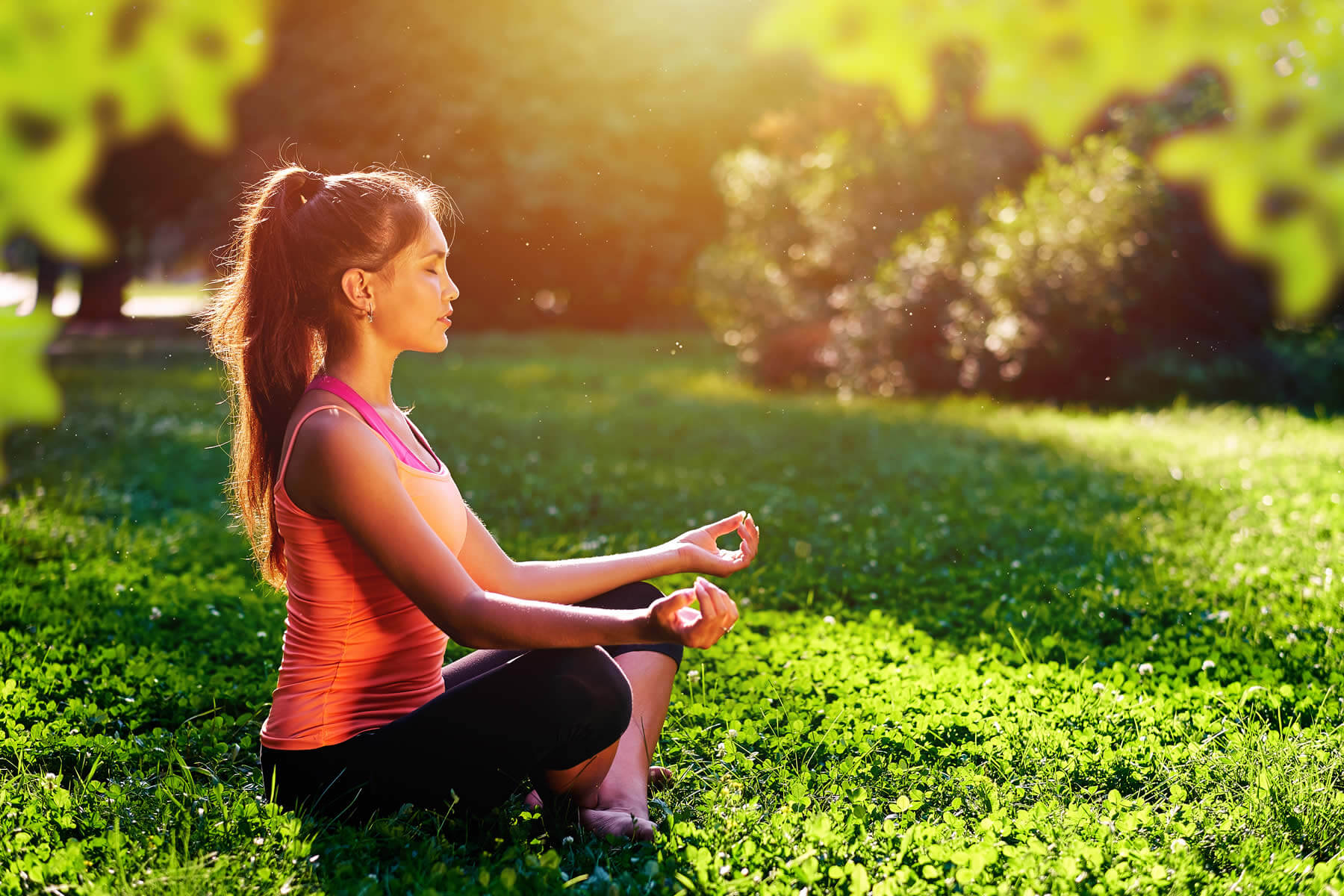 woman meditating in nature to overcome anxiety