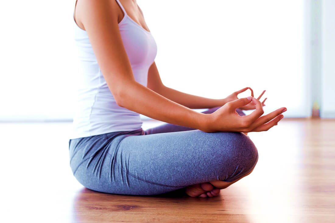Woman doing meditation as a way to practice self love