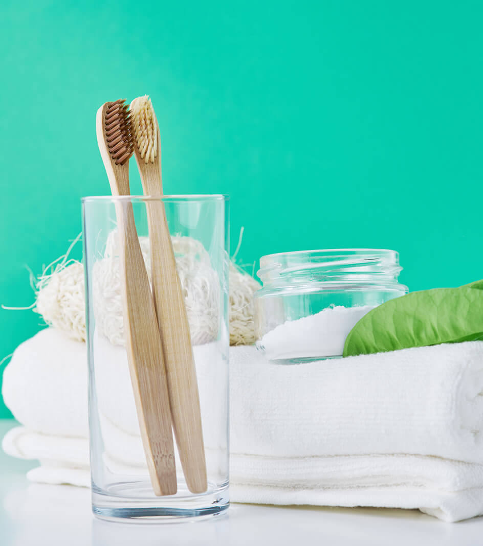Bamboo tooth brushes and baking soda as teeth whitening home remedies